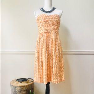 Anthropologie strapless orange print dress
